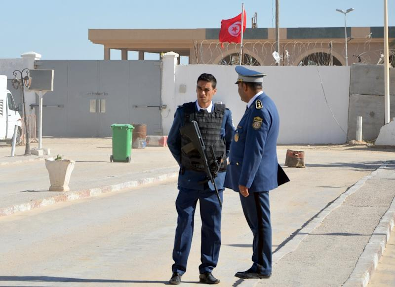 Tunisia police stand guard in front of the closed border between Tunisia and Libya in Ras Jdir on November 26, 2015