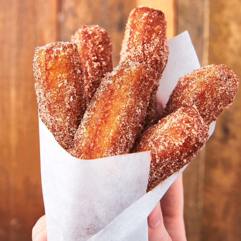 """<p>We don't often feel like breaking out all of our oil to fry things. But when you have an easy churro recipe this delicious, it's absolutely worth it. They only take a few minutes to fry and will actually still taste good at room temp, making them a great party dessert! </p><p>Get the <a href=""""https://www.delish.com/uk/cooking/recipes/a29733984/easy-churros-recipe/"""" rel=""""nofollow noopener"""" target=""""_blank"""" data-ylk=""""slk:Homemade Churros"""" class=""""link rapid-noclick-resp"""">Homemade Churros</a> recipe.</p>"""