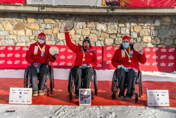 Canadian Lonnie Bissonnette, centre, will look to return to his winning ways on Tuesday after finishing third in Friday's para bobsleigh World Cup race.