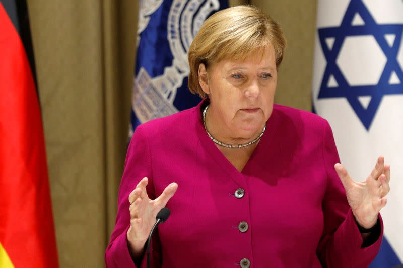German Chancellor Angela Merkel gestures as she delivers remarks following her meeting with Israeli President Reuven Rivlin in Jerusalem