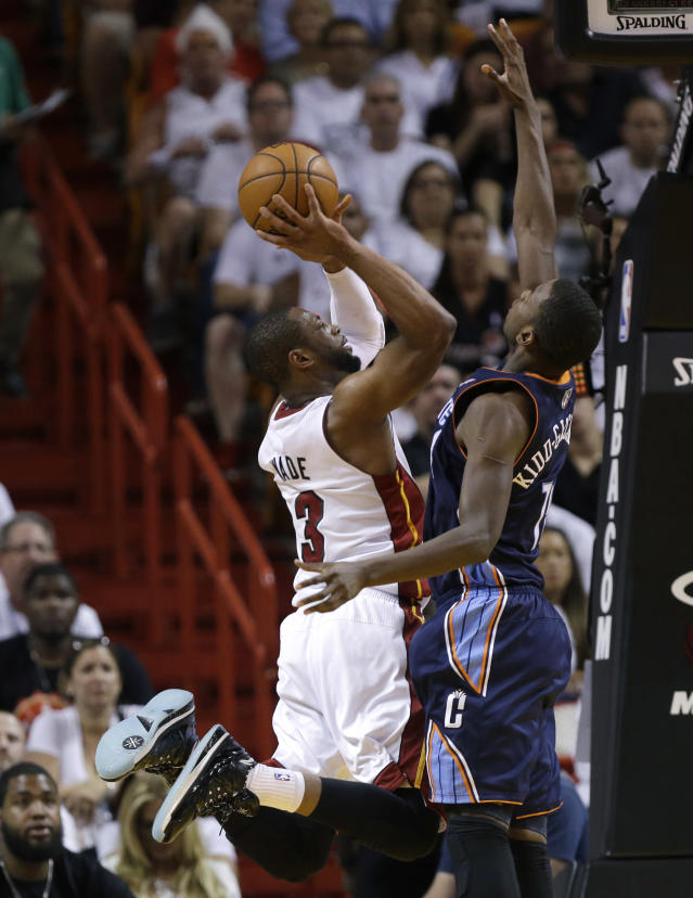 Miami Heat's Dwyane Wade (3) shoots as Charlotte Bobcats' Michael Kidd-Gilchrist defends during the second half in Game 2 of an opening-round NBA basketball playoff series, Wednesday, April 23, 2014, in Miami. The Heat defeated the Bobcats 101-97. (AP Photo/Lynne Sladky)