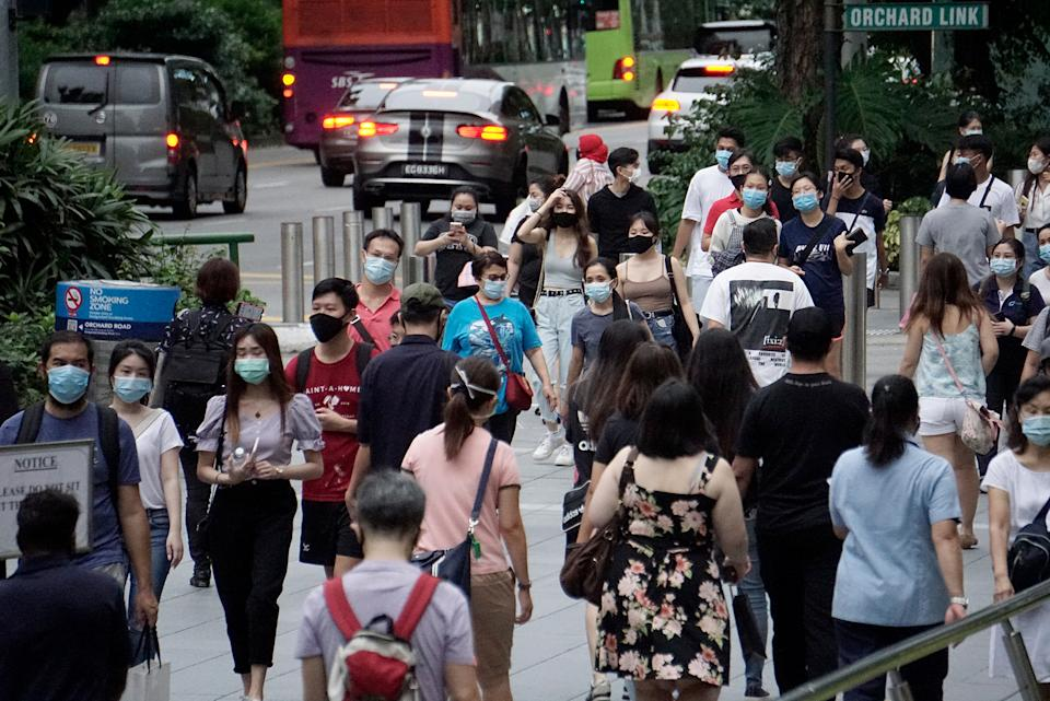 People in face masks seen along Orchard Road on 19 June 2020. (Yahoo News Singapore file photo)