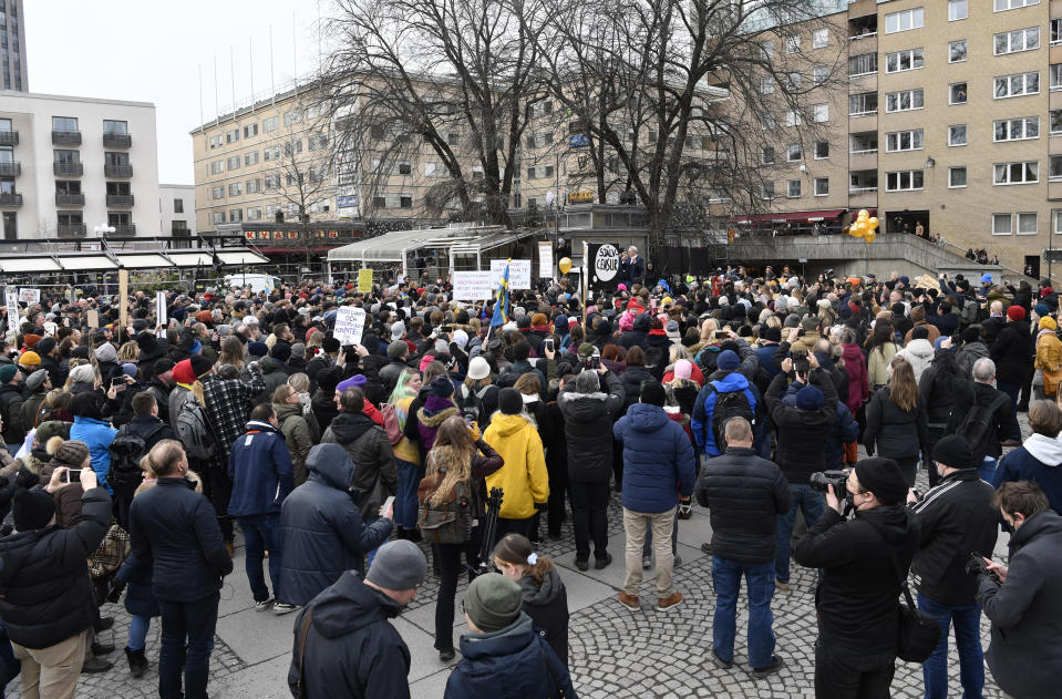 Anti-lockdown protesters demonstrate against coronavirus restrictions in Stockholm Saturday March 6, 2021. The protest was disbanded by police due to lack of permit for the public gathering. (Henrik Montgomery / TT via AP)