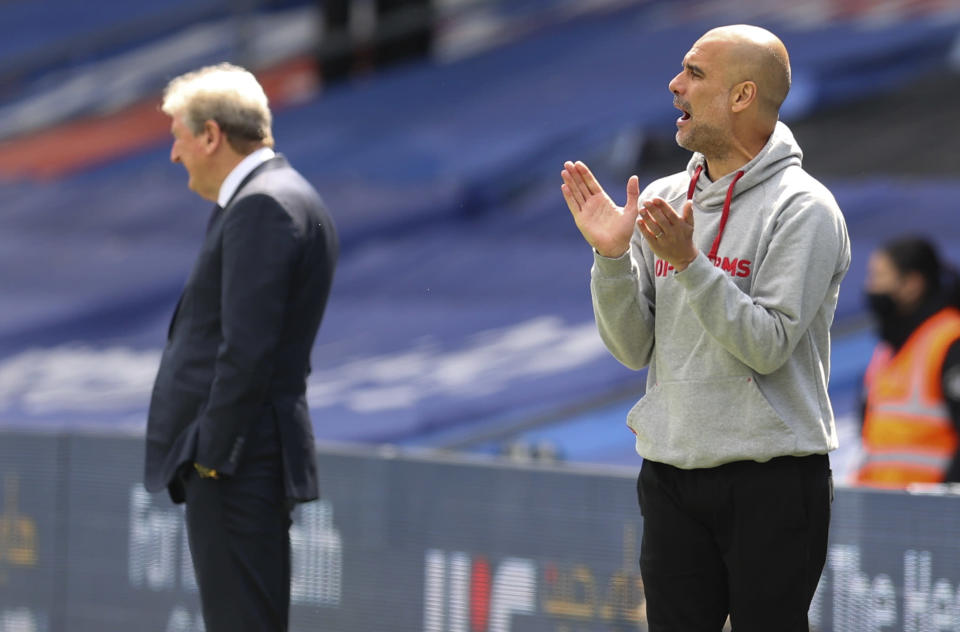 Manchester City's head coach Pep Guardiola gestures as he watches play during the English Premier League soccer match between Crystal Palace and Manchester City at Selhurst Park in London, England, Saturday, May 1, 2021. (AP Photo/Catherine Ivill/Pool)