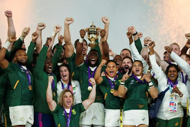 South Africa's captain Siya Kolisi lifts the trophy after a brilliant tournament (AFP Photo/Odd ANDERSEN)