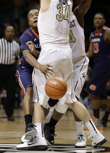 Auburn guard Josh Wallace, left, loses the ball as he collides with Vanderbilt forward Shelby Moats (34) in the second half of an NCAA college basketball game on Wednesday, Jan. 23, 2013, in Nashville, Tenn. Vanderbilt won 73-61. (AP Photo/Mark Humphrey)