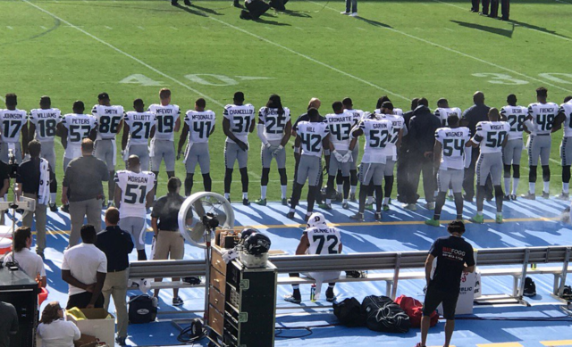 Michael Bennett chose not to stand for the national anthem in response to the violence in Charlottesville, Va. (Courtesy @Dennis TFP)