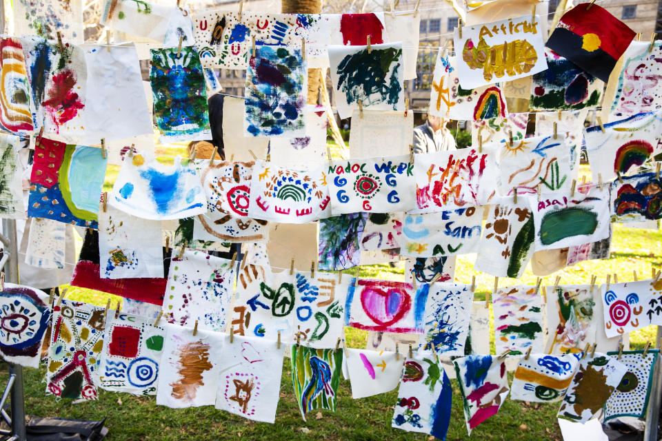 Artworks painted by children on the day are displayed at Hyde Park on July 13, 2019 in Sydney, Australia. NAIDOC Week celebrations are held across Australia each year to celebrate the history, culture and achievements of Aboriginal and Torres Strait Islander peoples. NAIDOC is celebrated not only in Indigenous communities, but by Australians from all walks of life. (Photo by Jenny Evans/Getty Images)