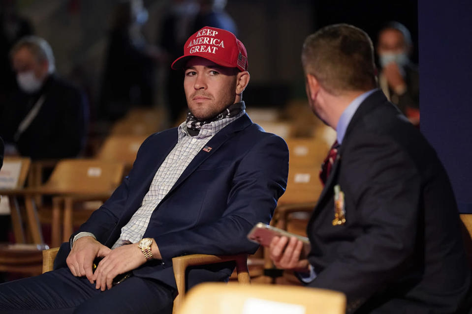 UFC fighter Colby Covington takes his seat as a guest of President Donald Trump to watch the first presidential debate Tuesday, Sept. 29, 2020, at Case Western University and Cleveland Clinic, in Cleveland, Ohio. (AP Photo/Patrick Semansky)