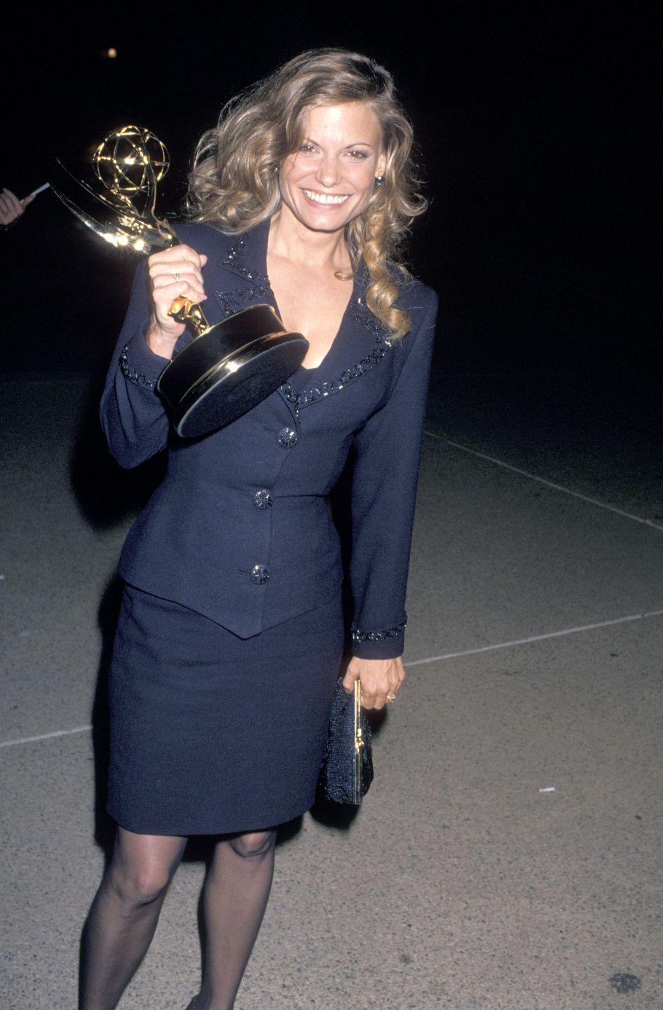 """<p>Winning for """"Midnight Caller,"""" Kay Lenz dons a navy suit and skirt combination. </p>"""