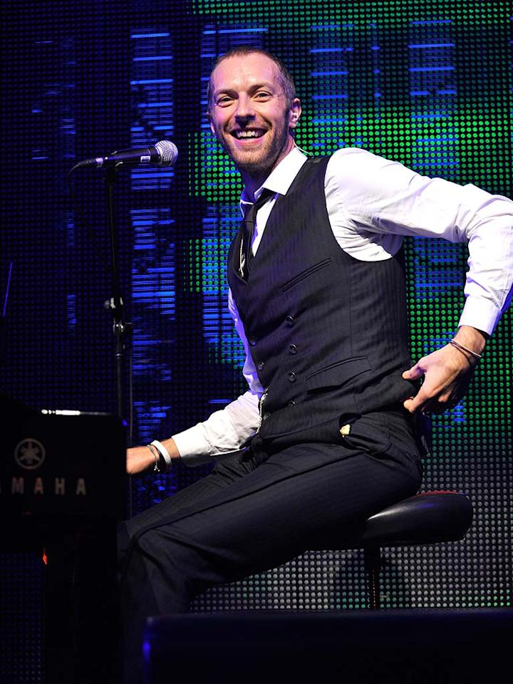 """Coldplay's Chris Martin was all smiles while performing for the crowd. Kevin Mazur/<a href=""""http://www.wireimage.com"""" target=""""new"""">WireImage.com</a> - October 15, 2009"""