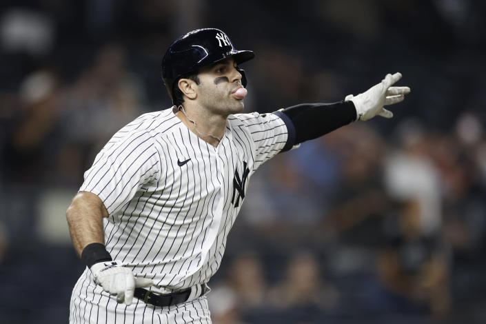 New York Yankees' Ryan LaMarre watches his walk-off single against the Philadelphia Phillies during the 10th inning of a baseball game Wednesday, July 21, 2021, in New York. The Yankees won 6-5. (AP Photo/Adam Hunger)