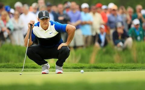 Brooks Koepka of the United States lines up a putt on the second green during the final round of the 2019 PGA Championship at the Bethpage Black course - Credit: Getty images