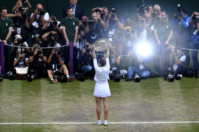 Romania's Simona Halep poses with the trophy after defeating United States' Serena Williams during the women's singles final match on day twelve of the Wimbledon Tennis Championships in London, Saturday, July 13, 2019.(Toby Melville/Pool Photo via AP)