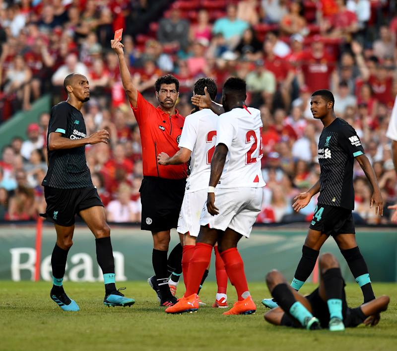 BOSTON, MASSACHUSETTS - JULY 21: (THE SUN OUT, THE SUN ON SUNDAY OUT) Gnagnon Joris Sevilla send off during a Pre-Season Friendly match between Sevilla and Liverpool at Fenway Park on July 21, 2019 in Boston, Massachusetts. (Photo by Andrew Powell/Liverpool FC via Getty Images)
