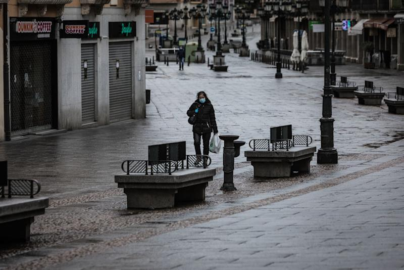 A woman wearing a face mask is seen walking on the streets of on the Segovia, Spain.