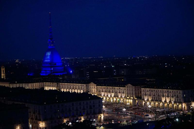 A picture of US astronaut Neil Armstrong walking on the Moon is projected on the Mole Antonelliana of Turin, Italy (EPA)