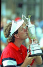 FILE - Mark Calcavecchia kisses the British Open trophy in Troon, Scotland, after a three-way playoff with Australia's Greg Norman and Wayne Grady, in this July 23, 1989, file photo. Past champions can play the British Open until they're 60. Because of the pandemic and spinal fusion surgery, Calcavecchia gets to play for the last time at St. Andrews next year. (AP Photo/Martin Cleaver, File)