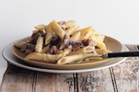 """Instead of traditional baked pasta, we broiled mozzarella-topped penne and sausage to get that bubbly melted cheese everyone loves, minus a lot of oven time. <a href=""""https://www.epicurious.com/recipes/food/views/sausage-and-mushroom-penne-gratin-350637?mbid=synd_yahoo_rss"""" rel=""""nofollow noopener"""" target=""""_blank"""" data-ylk=""""slk:See recipe."""" class=""""link rapid-noclick-resp"""">See recipe.</a>"""