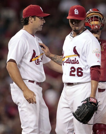 St. Louis Cardinals manager Mike Matheny, left, removes starting pitcher Kyle Lohse from a baseball game against the Philadelphia Phillies during the seventh inning Friday, May 25, 2012, in St. Louis. (AP Photo/Jeff Roberson)