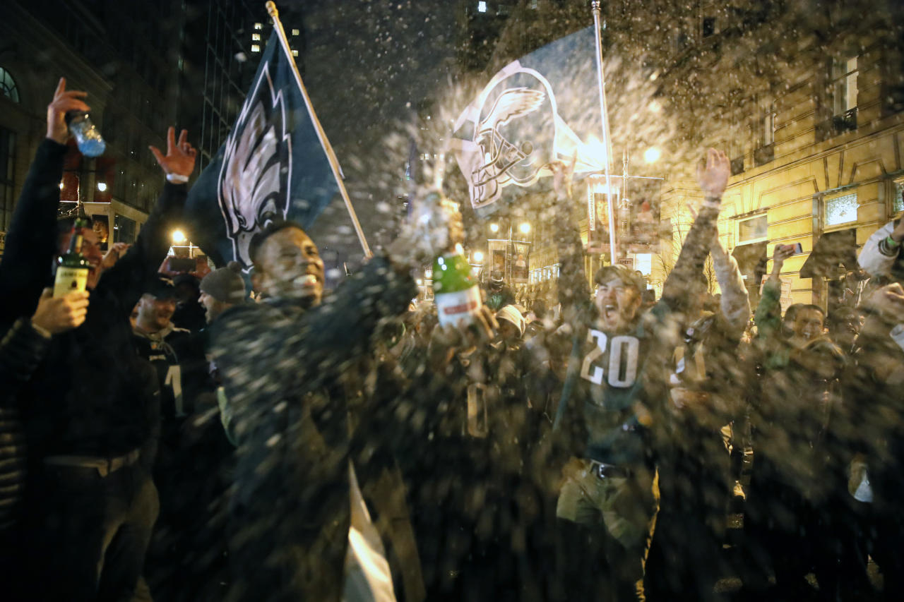 <p>Philadelphia Eagles fans celebrate the team's victory in NFL Super Bowl 52 between the Philadelphia Eagles and the New England Patriots, Monday, Feb. 5, 2018, in downtown Philadelphia. (AP Photo/Matt Rourke) </p>