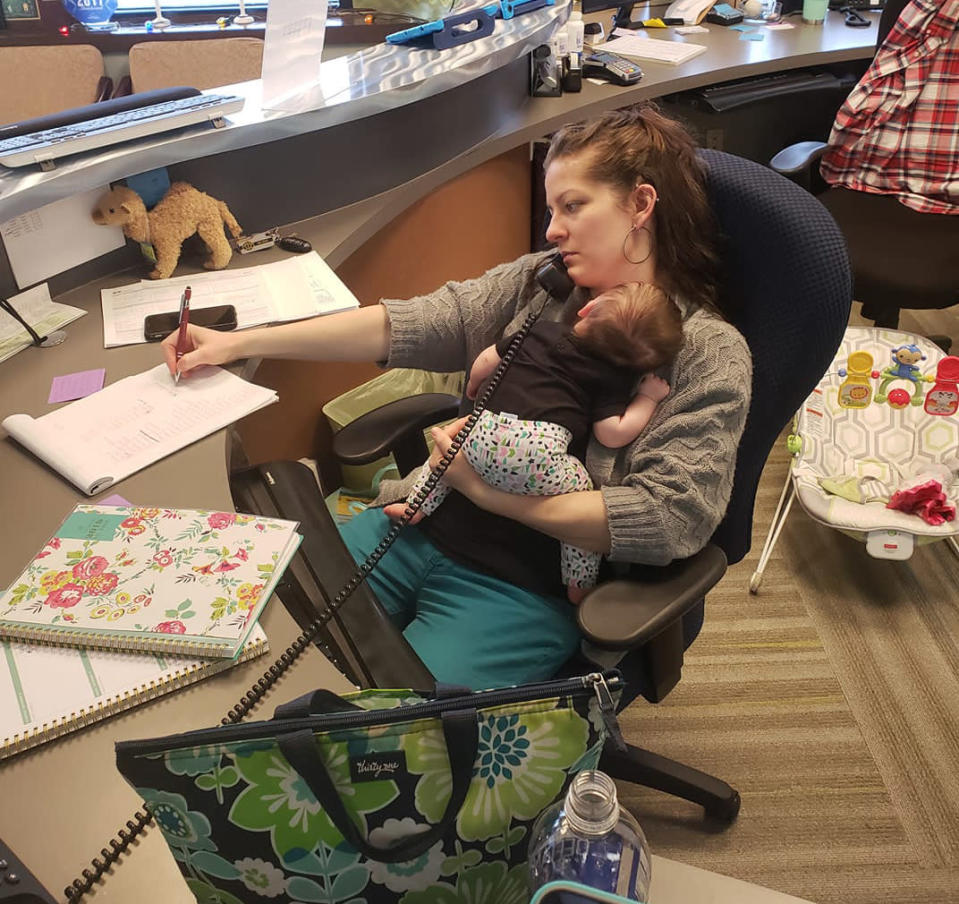 Melody Blackwell brings her baby to work once a week, and works from home the other four days. Her boss, who suggested the schedule, snapped this photo in December. (Photo: Dr. Elizabeth Baker via Facebook)