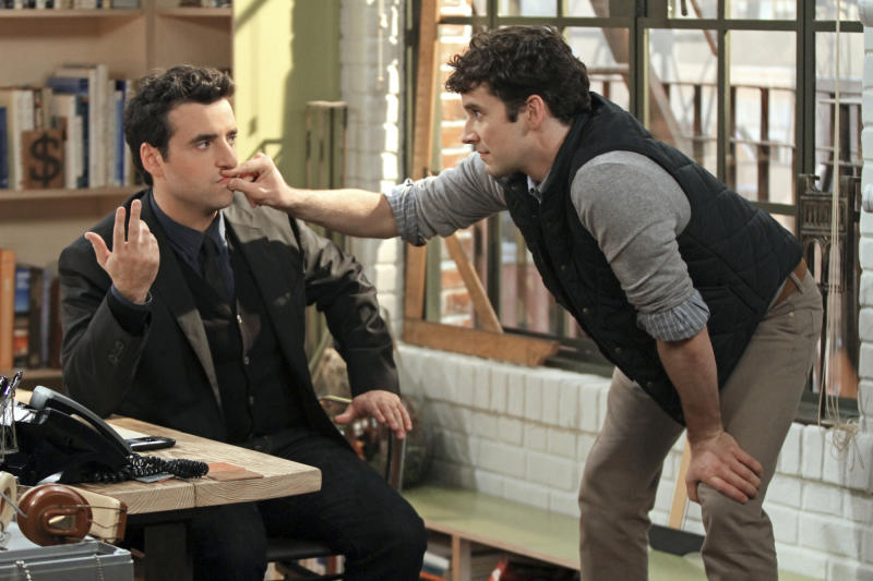 "This undated image released by CBS shows David Krumholtz, left, as Joe, a newly-engaged, accomplished architect and Michael Urie , who stars as Louis, Joe's gay co- worker and best friend in a scene from ""Partners,"" a comedy premiering Monday, Sept. 24, at 8:30 p.m. EST on CBS. (AP Photo/CBS, Matt Kennedy)"