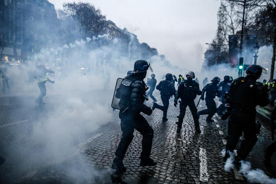 In Paris, the more than 8,000 police on duty easily outnumbered the 2,200 protesters (AFP Photo/Abdul ABEISSA)