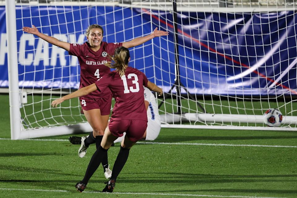 Santa Clara midfielder Skylar Smith (4) celebrates with teammate Julie Doyle (13) after scoring a goal against North Carolina during the semifinals of the NCAA College Cup.