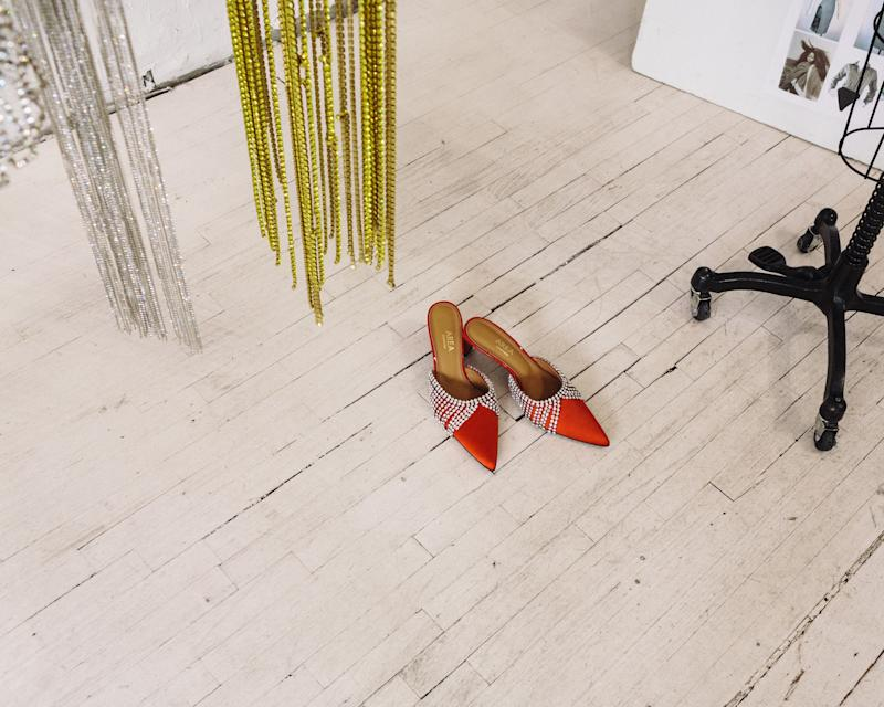 Crystal-trimmed mules on the studio floor
