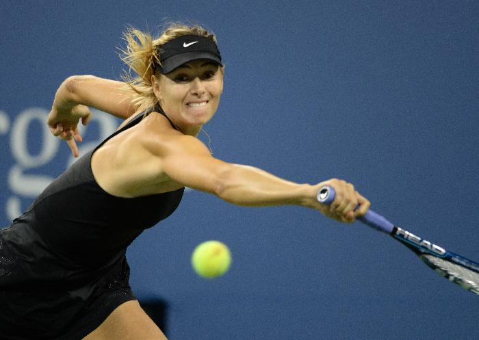 Maria Sharapova of Russia hits a return to Sabine Lisicki of Germany during their US Open 2014 women's singles match at the USTA Billie Jean King National Center August 29, 2014 in New York (AFP Photo/Don Emmert)