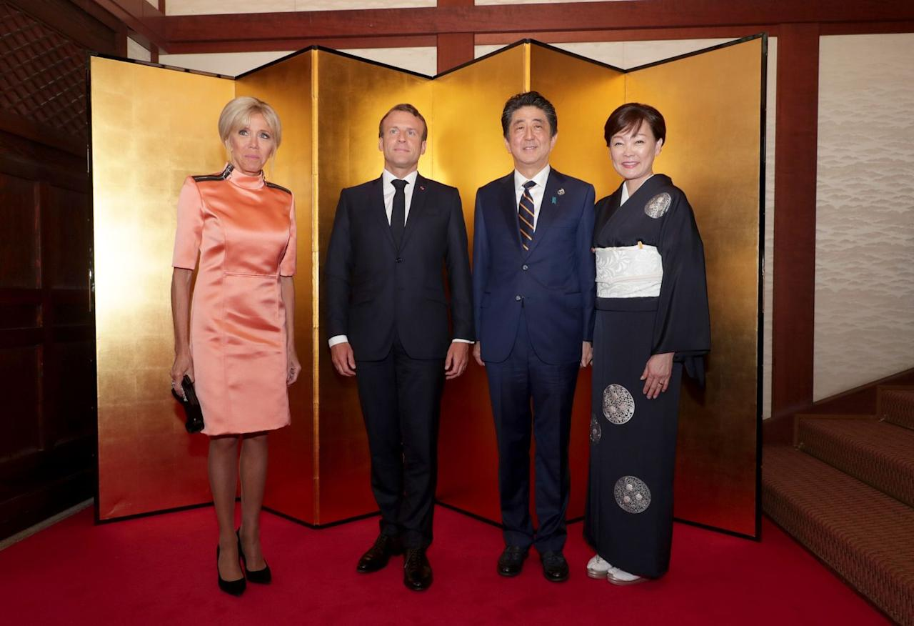<p>The first lady of France wore new age coral-hued shift dress with mod details to meet with Japanese Prime Minister Shinzo Abe and his wife Akie Abe, during the G20 summit in Osaka, Japan. </p>