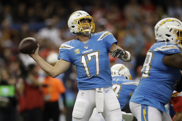 Los Angeles Chargers quarterback Philip Rivers throws a pass during the first half of an NFL football game against the Kansas City Chiefs on Nov. 18, 2019, in Mexico City. (AP Photo/Marcio Jose Sanchez)