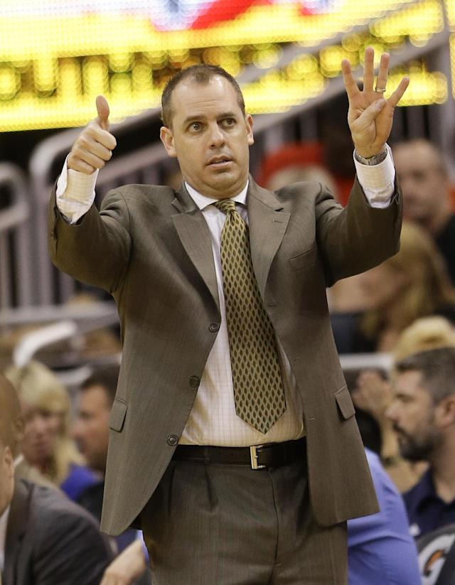 Indiana Pacers head coach Frank Vogel directs his players against the Orlando Magic during the first half of an NBA basketball game in Orlando, Fla., Wednesday, April 16, 2014. (AP Photo/John Raoux)