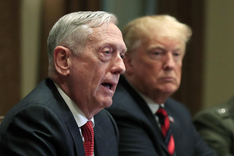 "FILE - In this Oct. 23, 2018 file photo, Defense Secretary Jim Mattis speaks beside President Donald Trump, during a briefing with senior military leaders in the Cabinet Room at the White House in Washington.  Mattis warns bitter political divisions have pushed American society to the ""breaking point"" in his most extensive public remarks since he resigned in protest from the Trump administration.  (AP Photo/Manuel Balce Ceneta)"