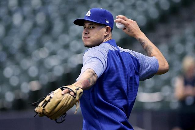 Manny Machado made a big impact in his Dodgers debut, reaching base four times in a 6-4 win against the Brewers. (Getty Images)