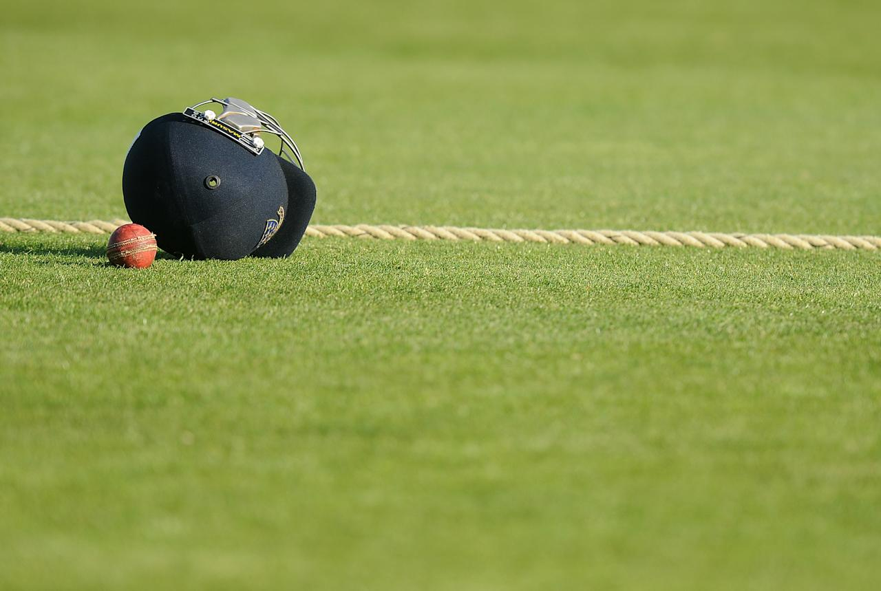 HOVE, ENGLAND - MAY 01: The old ball and players helmet sit on the boundary rope during day one of the LV County Championship match between Sussex and Warwickshire at The Brighton and Hove Jobs County Ground on May 01, 2013 in Hove, England. (Photo by Charlie Crowhurst/Getty Images)