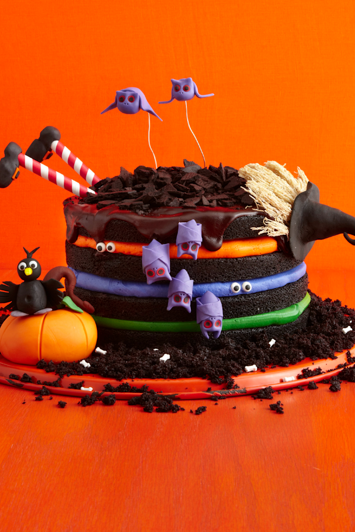"""<p>With a little fondant and a lot of patience, this clever cake will be a showstopper this Halloween.</p><p><strong><em><a href=""""https://www.womansday.com/food-recipes/food-drinks/recipes/a51843/black-chocolate-cake/"""" rel=""""nofollow noopener"""" target=""""_blank"""" data-ylk=""""slk:Get the Black Chocolate Witch Cake recipe."""" class=""""link rapid-noclick-resp"""">Get the Black Chocolate Witch Cake recipe. </a></em></strong></p>"""