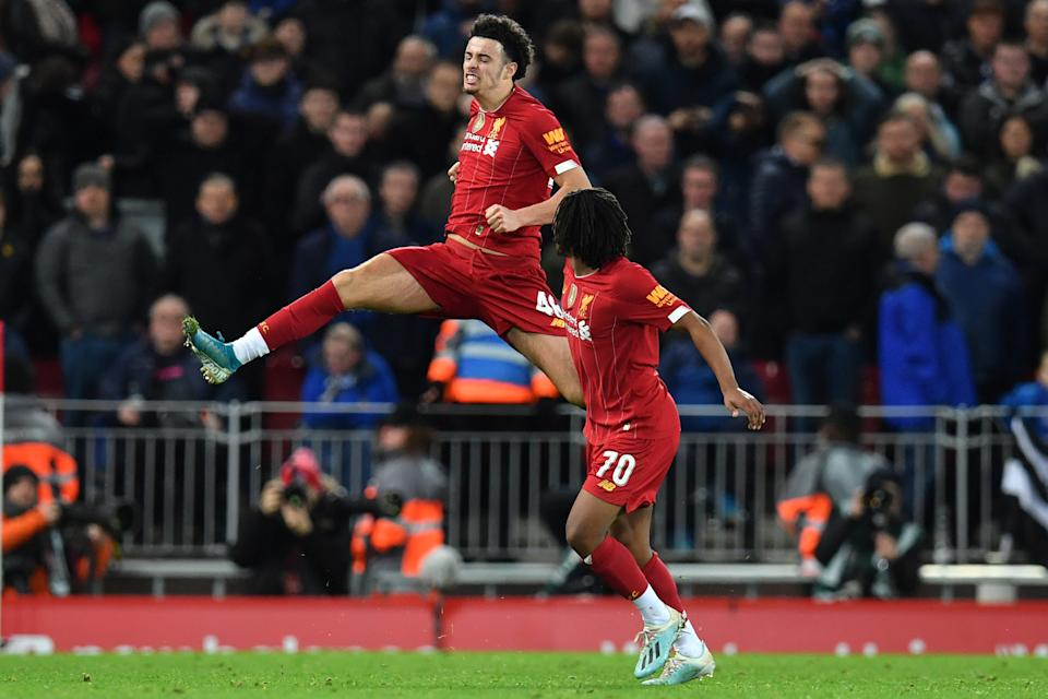 Liverpool's English midfielder Curtis Jones (L) celebrates after scoring the opening goal of the English FA Cup third round football match between Liverpool and Everton at Anfield in Liverpool, north west England on January 5, 2020. (Photo by Paul ELLIS / AFP) / RESTRICTED TO EDITORIAL USE. No use with unauthorized audio, video, data, fixture lists, club/league logos or 'live' services. Online in-match use limited to 120 images. An additional 40 images may be used in extra time. No video emulation. Social media in-match use limited to 120 images. An additional 40 images may be used in extra time. No use in betting publications, games or single club/league/player publications. /  (Photo by PAUL ELLIS/AFP via Getty Images)