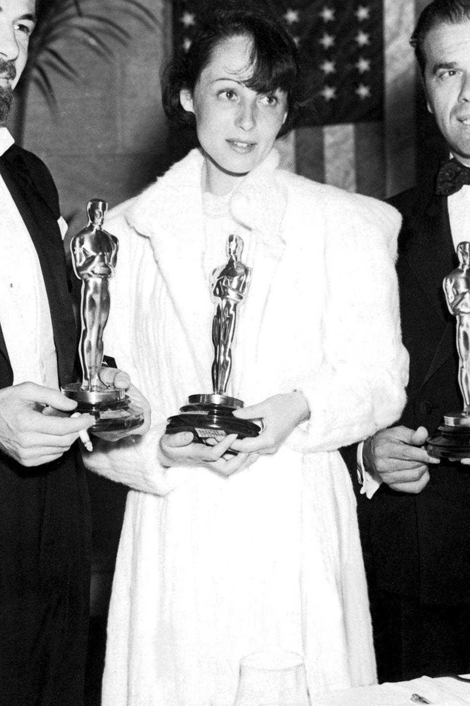 <p>And here she is with her first Oscar win in a fabulous, long white coat. She won Best Actress for her performance in <em>The Great Ziegfeld</em>. </p>