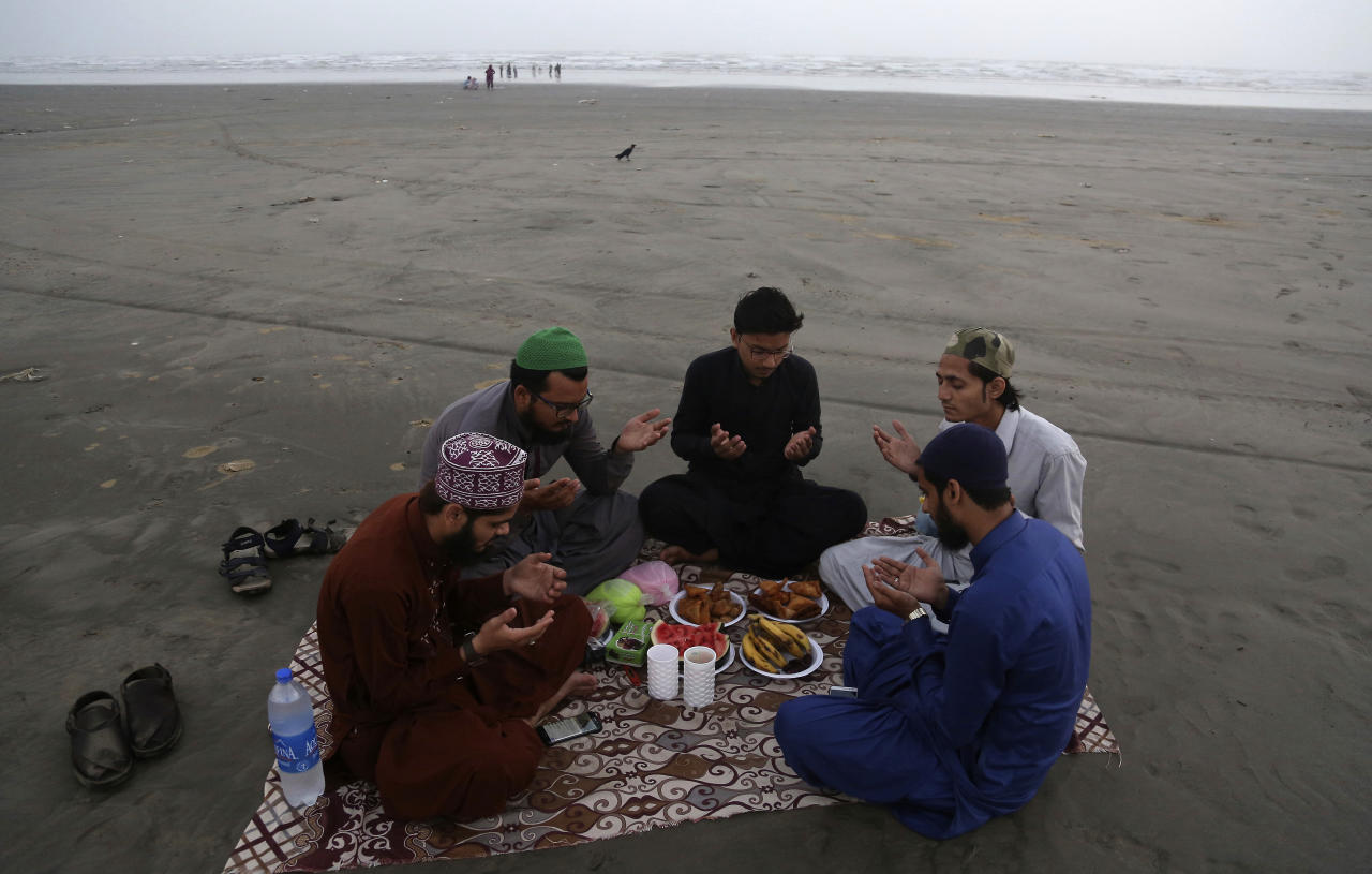 Pakistani Muslims pray before breaking their fast at the Clifton Beach in Karachi, Pakistan, Monday, May 29, 2017. Muslims throughout the world are observing Ramadan, the holiest month in the Islamic calendar, refraining from eating, drinking, smoking and sex from sunrise to sunset. (AP Photo/Shakil Adil)