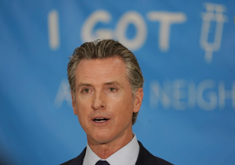 California Gov. Gavin Newsom announces a massive jackpot as the nation's most populous state looks to encourage millions of people who are still unvaccinated to get their shots at a news conference at the Esteban E. Torres High School in Los Angeles, Thursday, May 27, 2021. California is giving away the country's largest pot of vaccine prize money — $116.5 million — in an attempt to get millions more inoculated before the most populous U.S. state fully reopens next month. Newsom on Thursday announced the prizes, which also include the nation's highest single vaccine prize: $1.5 million. (AP Photo/Damian Dovarganes)