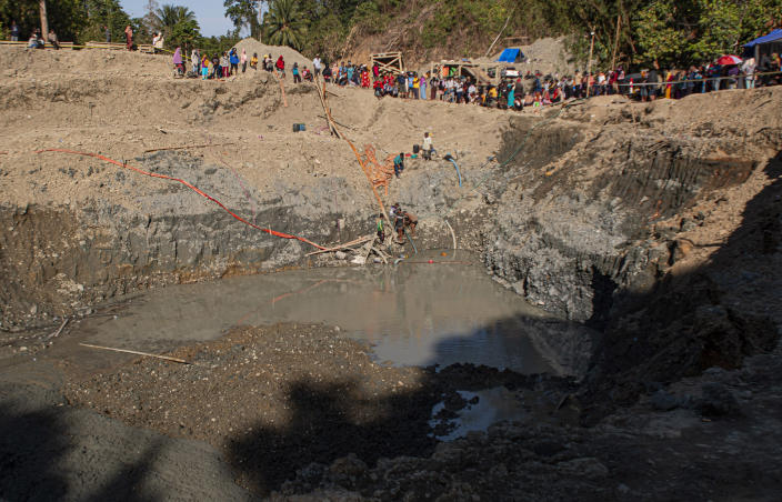 Rescuers search for victims at a collapsed gold mine in Parigi Moutong, Central Sulawesi, Indonesia, Thursday, Feb. 25, 2021. The illegal gold mine in Central Indonesia collapsed on miners working inside, leaving a number of people killed, officials said Thursday. (AP Photo/M. Taufan)