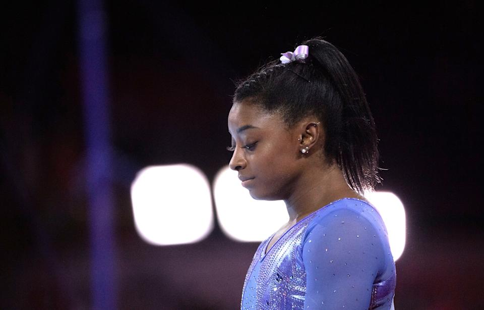 Simone Biles prepares for her routine on the uneven bars