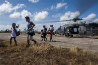 Civilians exit a Sea Hawk helicopter from the Golden Falcons of Helicopter Sea Combat Squadron after being airlifted from an area of the Philippines affected by Typhoon Haiyan in Eastern Samar, Philippines in this November 15, 2013 picture provided by the U.S. Navy. REUTERS/U.S. Navy/Mass Communication Specialist Seaman Liam Kennedy/Handout via Reuters