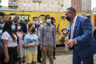 """FILE - In this Tuesday, Aug. 17, 2021 file photo, Education Secretary Miguel Cardona speaks to students outside P.S. 5 Port Morris, a Bronx elementary school in New York. With new federal pandemic funding, he says,""""This is our moment to ensure that we reopen, reinvest and reimagine our schools differently and better than ever before,"""" Cardona said at a virtual education summit in June. """"These next months and years will determine the trajectory of success for millions of students in our care."""" (AP Photo/Brittainy Newman)"""