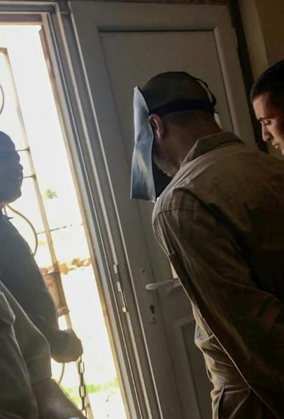 An image grab taken from an AFPTV video shows Belgian jihadist Tarik Jadaoun being escorted out of court after his trial in Baghdad on May 22, 2018
