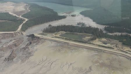 The results of a tailing pond breach at Imperial Metals Corp's gold and copper mine at Mount Polley in central British Columbia are pictured in this still image from aerial handout video