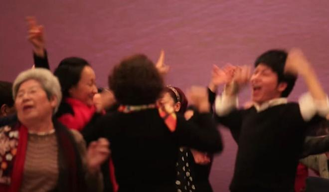 People dance ecstatically in a video posted by the Create Abundance YouTube channel in 2014. Photo: YouTube