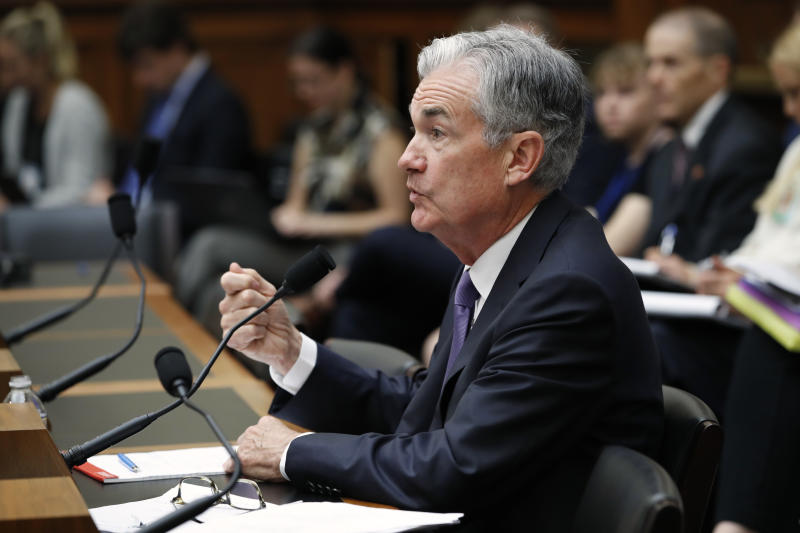 Fed says trade war downturn could pose challenges